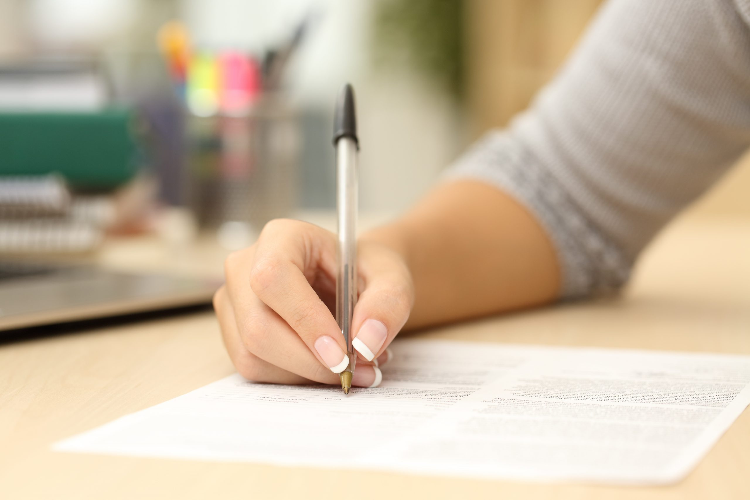Woman signing a contract or form
